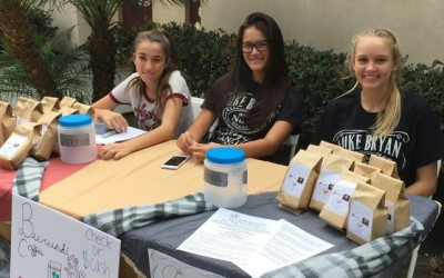 Eighth graders at Saint John School raise money for a Burundi library through coffee donations. Left to right: Skylar Demers, Kaylee Yokota and Hannah Blackburn. — Courtesy photo ( http://www.encinitasadvocate.com )