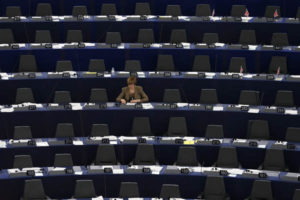 A Member of the European Parliament attends a debate on the situation in Ukraine at the European Parliament in Strasbourg, February 26, 2014. REUTERS/Vincent Kessler (FRANCE - Tags: POLITICS)