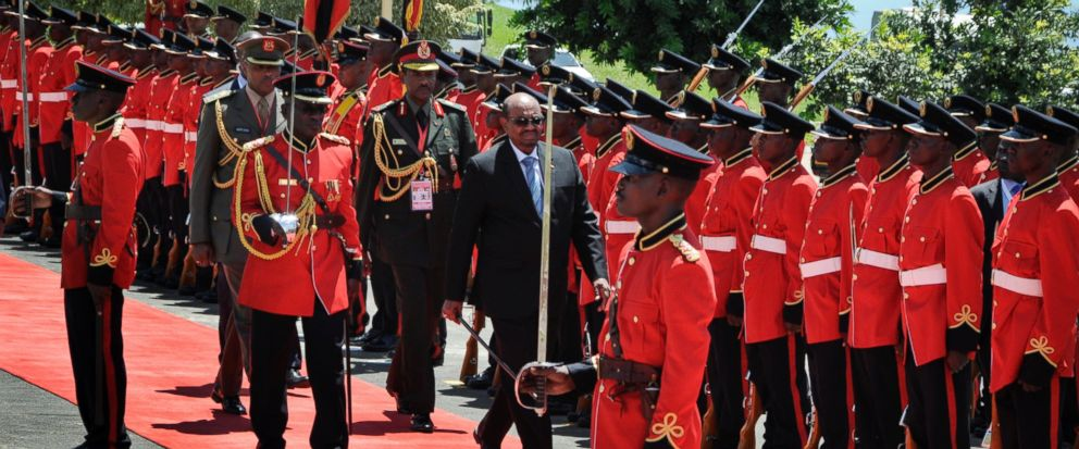 ( Photo : Sudan's President Omar al-Bashir, center, inspects the guard of honor after his arrival at State House in Entebbe, Uganda Monday, Nov. 13, 2017. Rights groups on Monday urged Ugandan authorities to arrest the visiting president of Sudan, who has long been wanted by the International Criminal Court for serious crimes. (AP Photo/Ronald Kabuubi) )